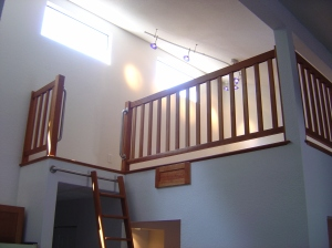 Railings, hand rails and ladder completed and installed. Matching cabinet is for storage of the ladder when not in use.