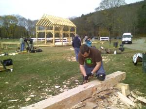 Bill hewing the log into a square timber