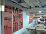Filling up the pegboards with copper painted hardware