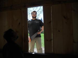 Bill cutting through the wall to install my window.