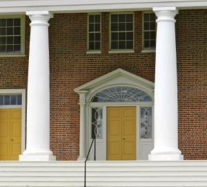 Front door flanked by columns