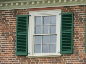 Window with louvered shutters.