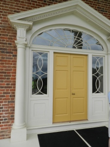 The side lights flanking the door can lower into recessed pockets to promote air flow