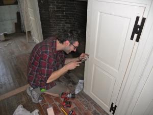 Martin Hickman fine tuning some hardware during installation