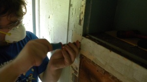 Carefully removing pins so we can disassemble the paneling