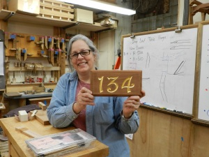 Janet Collins with completed sign