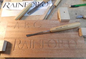 Completed name carving