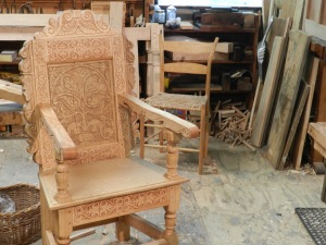 Beautiful carved chair. In the background a chair built to the specs from 'Make A Chair From A Tree : An Introduction To Working Green Wood' which was the inspiration for Peter's 'Make a joint stool from a tree' book.