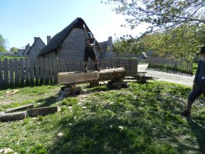 Justin Keegan (NBSS CFM + Plimoth Interpretter) hewing a log