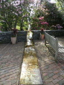 The Heritage Museum's trough that leads seemingly uphill to a waterfall. Very Neat.