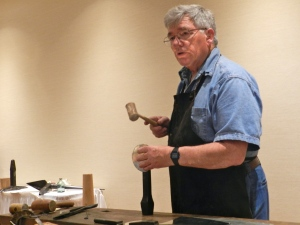 Bill McMillen demonstrating how to tinsmith as he makes a cup