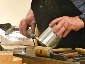 Soldering a tin cup
