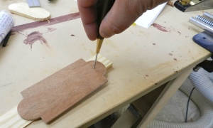 Drill mounting holes with a brad awl