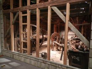 Peering into the Dominy Furniture Workshop from Long Island, NY you can see the great wheel lathe and workbenches