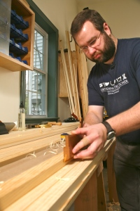 Bill Rainford using molding planes to reproduce traditional molding profiles. (Photo courtesy of the Taunton Press)