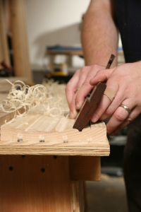 Using traditional molding planes to replicate the profile. (Photo courtesy of the Taunton Press)