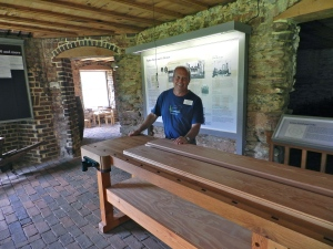 Senior Restoration Craftsman David Clauss with the long joiner's bench he build
