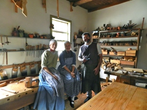 Interpreters in the Joiner's workshop inside the Single Brother's House Shop