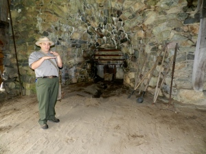 Ranger Curtis White explaining how the ironworks produced iron