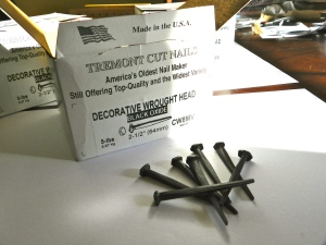 Decorative wrought head cut nails used for wide pine flooring