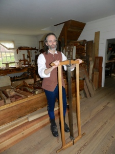 Ed Wright with a frame saw in Anthony Hay Cabinetmaker's Shop