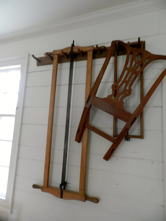 Frame saws hanging on the wall of the Hay Shop