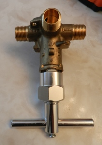 Cartridge extraction tool on a sample valve body