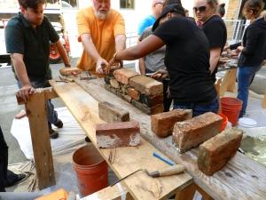 Dierdre building a brick wall