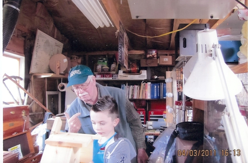 James A. Clarke sharing his love for woodworking with the next generation.
