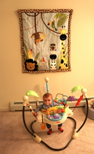 Bradley in front of his new wall hanging