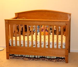 Crib outfitted with mattress, sheets, skirt and of course stuff animals