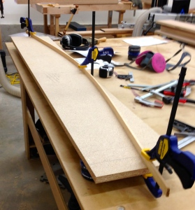Using a fairing stick to lay out the curve for the headboard and templates