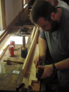 Demonstrating the use of a molding plane on a sticking board. (Photo by Carol Coutinho)