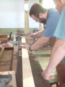 Making the miters with a miter box. (Photo by Carol Coutinho)