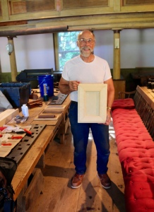 Tom with his finished picture frame.