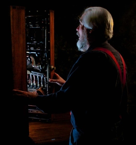 Don Williams gazing upon the Studley Tool Cabinet (Photo by Narayan Nayar and linked from http://www.studleytoolchest.com/)