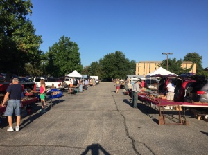 The first of three aisles of vendors out in the parking lot.