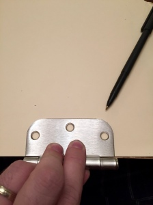 Use one of the hinges as a template.