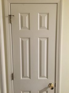 BEFORE: Existing door with brass hardware sagging