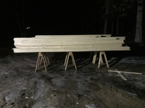 "A LOT of shiplap siding on horses. 10-12"" wide 16' long pieces"