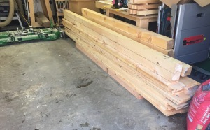 Large pile of green eastern white pine ready to go.