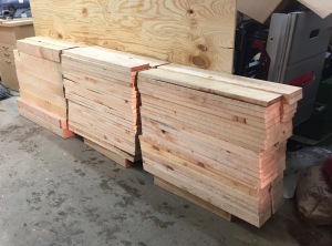 Stacks of cut legs and beams back in the shop