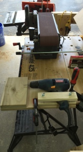 Drilling jig for pins (Foreground). Belt sander and disc sander for cleaning up and fitting box tops and bottoms