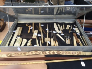 Vendor with an extensive collection of tools make from bones and ivory.