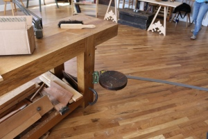 Nice swing out adjustable seat attached to the workbench leg