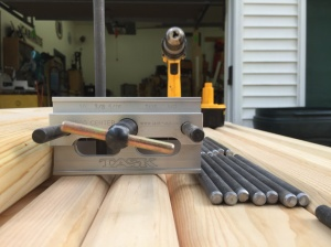 Doweling jig used to center and guide holes drilled into the end of the posts.