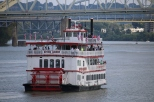 A paddlewheel sightseeing boat out on the river.