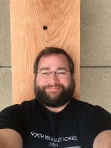Selfie while laying on a Roman bench in the middle of a city sidewalk.