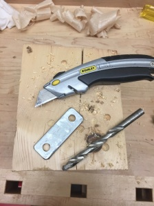 Use a utility knife to clean up the cork around the edges of the plate and the 3/8' drill bit to clean up and cork in the holes