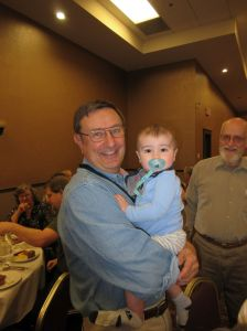 Paul Van Pernis at the EAIA Annual Meeting 2015 holding my son Bradley. :-)